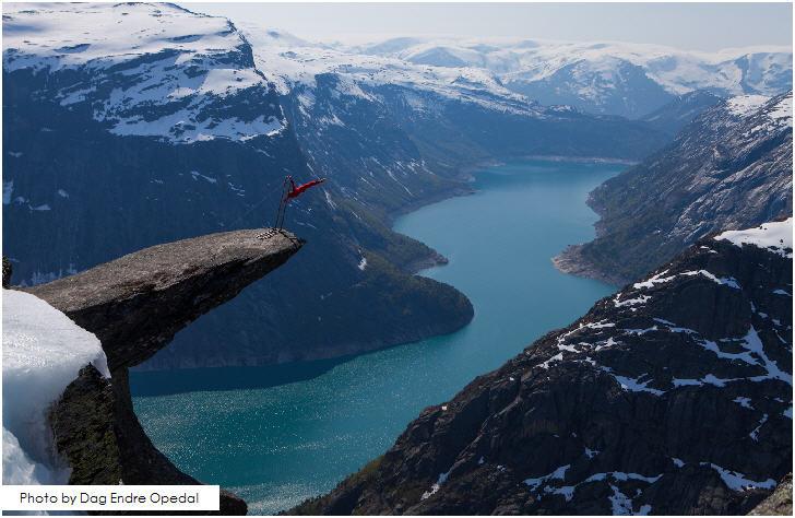 A balancing act by Norwegian extreme artist Eskil Rønningsbakken at Trolltunga, Norway