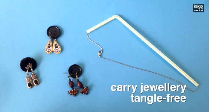 Place earrings in buttons and necklace in straw to carry jewellery tangle-free