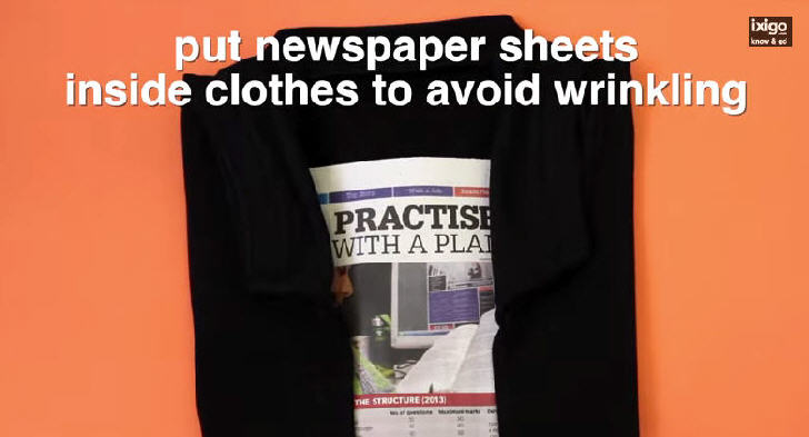 Put newspaper sheets inside clothes to avoid wrinkling