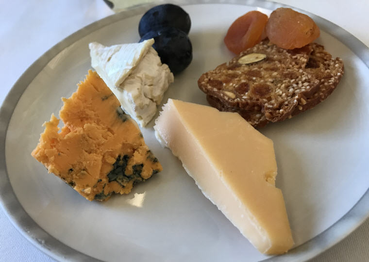 Selection of Cheeses: Oud Amsterdam, Shropshire Old Cheese and Normandy Camembert with garnishes
