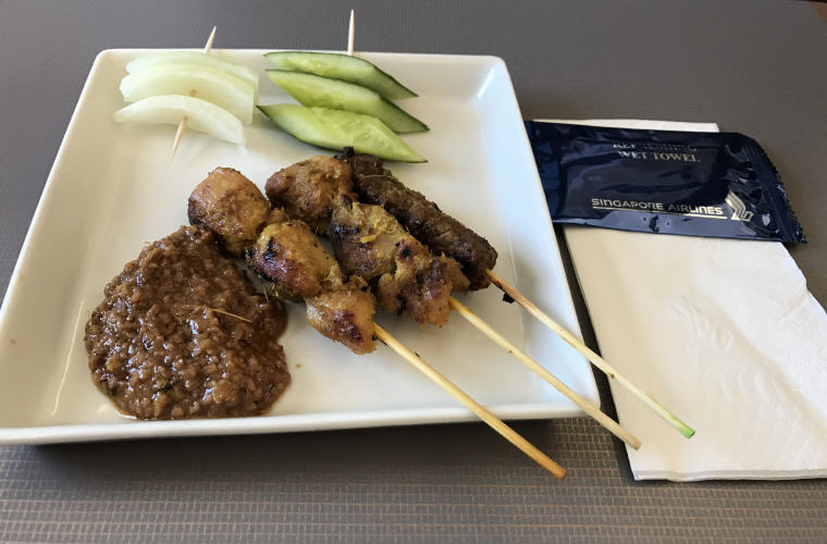 Singapore Chicken and Beef Satay, with onion, cucumber and spicy peanut sauce