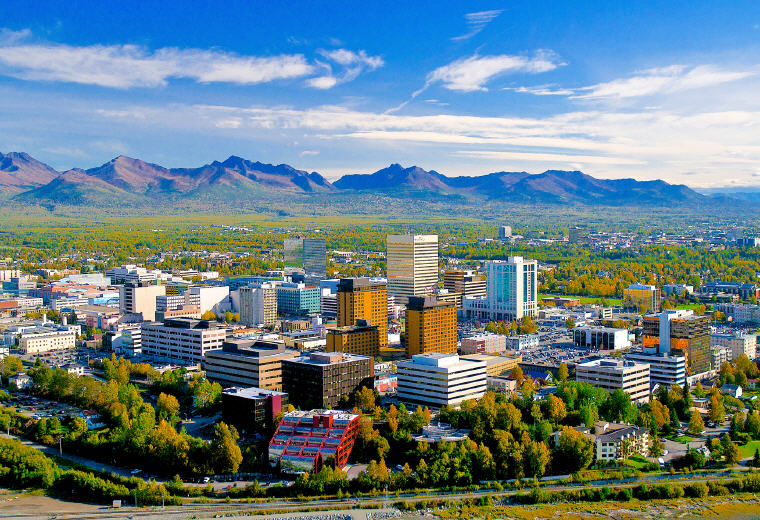 The Anchorage skyline with the Chugach Mountains to the east, Credit: Frank Flavin, Visit Anchorage, America's Top 50 summer vacation destinations this summer