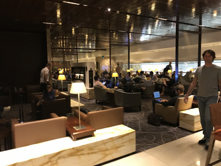 Packed with travellers at 11pm, SilverKris Lounge, Changi Airport T3