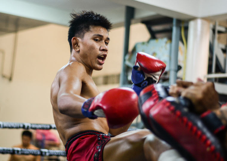 Thai boxer showing his fierce determination, What to Do in Bangkok: 5 Insider's Tips by Local Experts