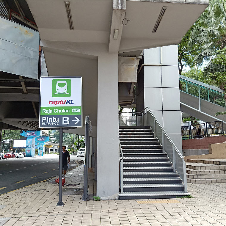 Getting down from Raja Chulan Monorail Station Entrance B